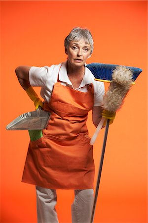 rubber apron woman - Portrait of Woman With Cleaning Products Stock Photo - Premium Royalty-Free, Code: 600-01613561