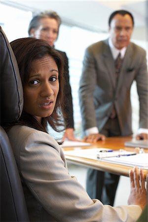 Businesswoman in Meeting Looking Nervous Stock Photo - Premium Royalty-Free, Code: 600-01613741