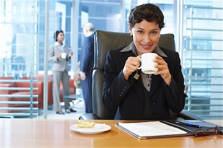 Businesswoman Drinking a Cup of Coffee Stock Photo - Premium Royalty-Free, Code: 600-01613752