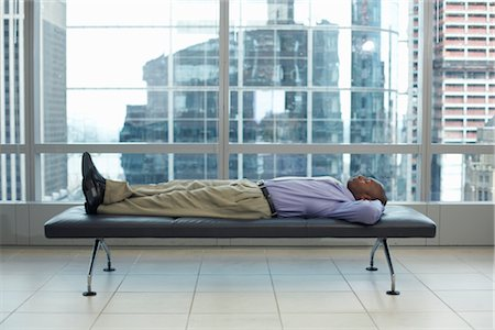 Businessman Lying Down Stock Photo - Premium Royalty-Free, Code: 600-01613872