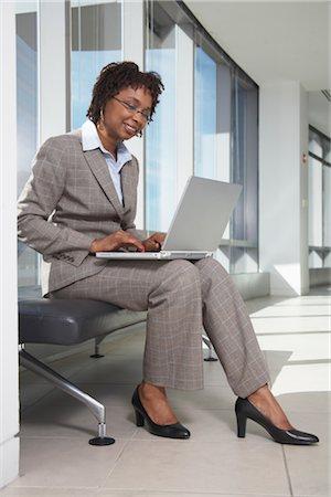 Businesswoman Using Laptop Computer Stock Photo - Premium Royalty-Free, Code: 600-01613908