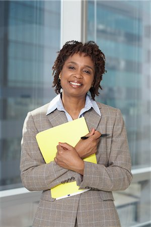 Businesswoman with Document Stock Photo - Premium Royalty-Free, Code: 600-01613917