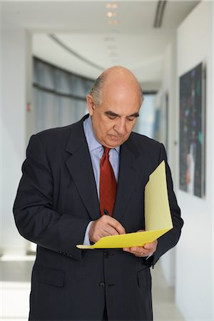 Businessman with File Folder Stock Photo - Premium Royalty-Free, Code: 600-01613964