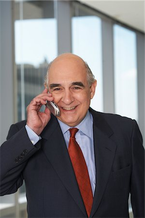 Businessman with Cellular Phone Stock Photo - Premium Royalty-Free, Code: 600-01613962