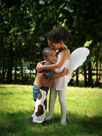 people kissing little boys - Girl and Boy Hugging in Yard Stock Photo - Premium Royalty-Free, Code: 600-01644678