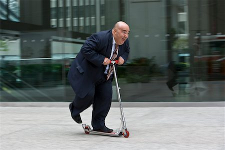 fat man exercising - Businessman on Scooter Stock Photo - Premium Royalty-Free, Code: 600-01646037