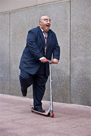 fat man exercising - Businessman on Scooter Stock Photo - Premium Royalty-Free, Code: 600-01646038
