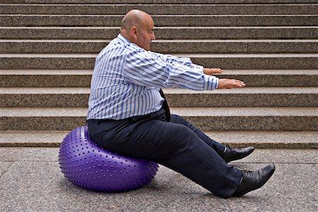 fat man exercising - Businessman Using Exercise Ball Stock Photo - Premium Royalty-Free, Code: 600-01646039
