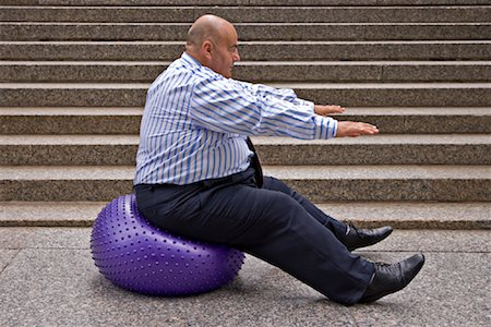 fat man balls - Businessman Using Exercise Ball Stock Photo - Premium Royalty-Free, Code: 600-01646039