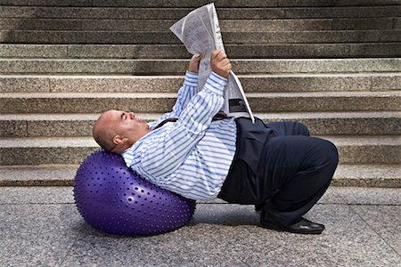 fat man balls - Businessman with Exercise Ball and Newspaper Stock Photo - Premium Royalty-Free, Code: 600-01646040
