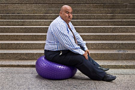 fat man exercising - Businessman Using Exercise Ball Stock Photo - Premium Royalty-Free, Code: 600-01646042