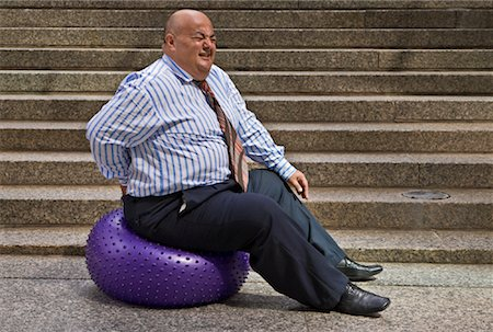 fat man exercising - Businessman Using Exercise Ball Stock Photo - Premium Royalty-Free, Code: 600-01646043