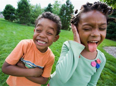 Siblings Making Faces Stock Photo - Premium Royalty-Free, Code: 600-01646326
