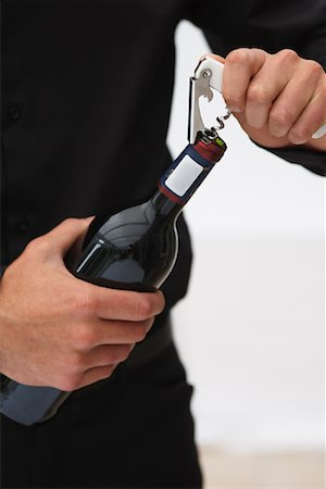 Man Opening Bottle of Wine Stock Photo - Premium Royalty-Free, Code: 600-01646510
