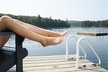Woman Relaxing on Dock Stock Photo - Premium Royalty-Free, Code: 600-01670911