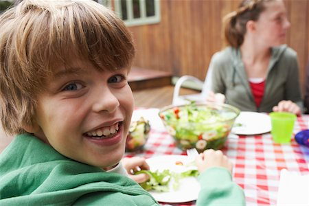 Boy and Girl at Outdoor Dinner Table Stock Photo - Premium Royalty-Free, Code: 600-01694197