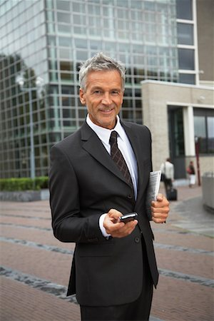 Businessman with Electronic Organizer, Amsterdam, Netherlands Stock Photo - Premium Royalty-Free, Code: 600-01695560