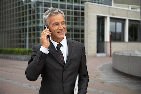 Businessman with Cellular Phone, Amsterdam, Netherlands Stock Photo - Premium Royalty-Free, Code: 600-01695563