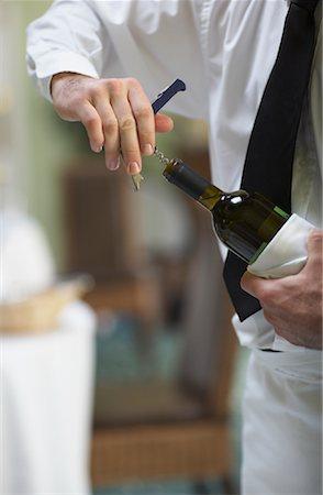 Waiter Opening Bottle of Wine Stock Photo - Premium Royalty-Free, Code: 600-01693915