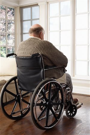 Senior Man in Wheelchair, Looking Out Window Stock Photo - Premium Royalty-Free, Code: 600-01716126