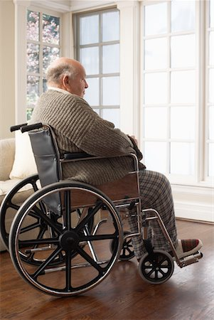 Senior Man in Wheelchair, Looking Out Window Stock Photo - Premium Royalty-Free, Code: 600-01716127