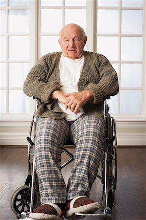 Portrait of Senior Man in Wheelchair Stock Photo - Premium Royalty-Free, Code: 600-01716128