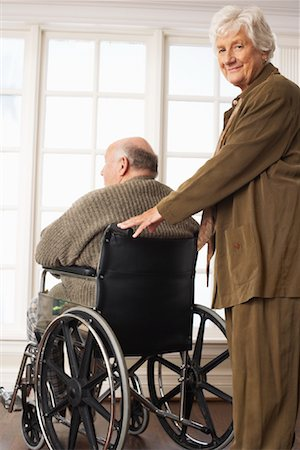Senior Man Receiving Assistance with Wheelchair Stock Photo - Premium Royalty-Free, Code: 600-01716130