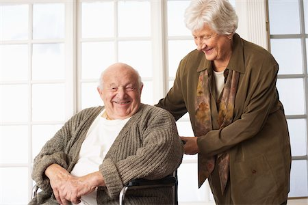 Senior Man Receiving Assistance with Wheelchair Stock Photo - Premium Royalty-Free, Code: 600-01716132