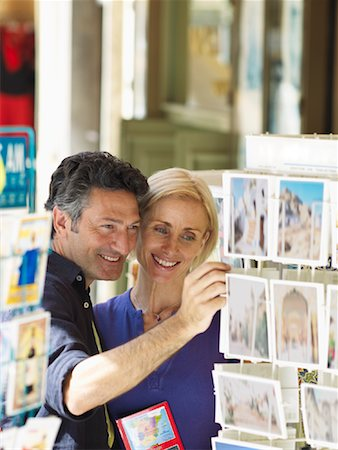 Couple Looking at Postcards Stock Photo - Premium Royalty-Free, Code: 600-01716389
