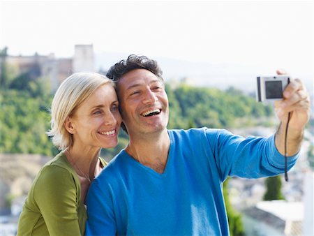 Couple Taking Photo of Themselves Stock Photo - Premium Royalty-Free, Code: 600-01716398