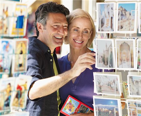 Couple Looking at Postcards Stock Photo - Premium Royalty-Free, Code: 600-01716391