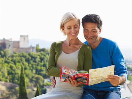 Couple Looking at Map Stock Photo - Premium Royalty-Free, Code: 600-01716400