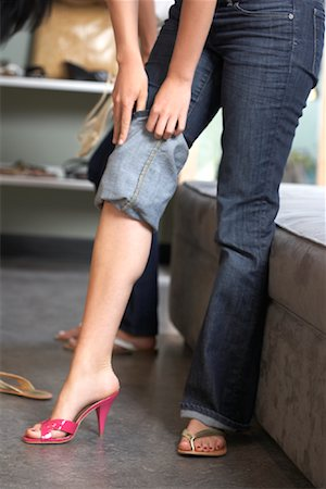 Woman Trying on Shoes Stock Photo - Premium Royalty-Free, Code: 600-01716413