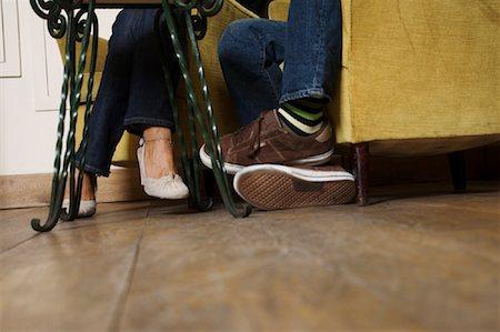 Feet of Couple Sitting Stock Photo - Premium Royalty-Free, Code: 600-01716771