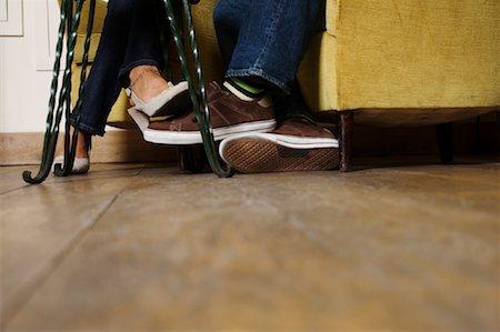 Couple Playing Footsie Stock Photo - Premium Royalty-Free, Code: 600-01716772