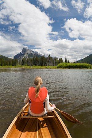 Girl Canoeing in Vermilion Lakes, Banff National Park, Alberta, Canada Stock Photo - Premium Royalty-Free, Code: 600-01716789