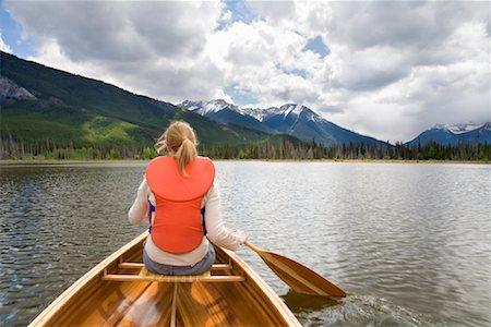 Girl Canoeing in Vermilion Lakes, Banff National Park, Alberta, Canada Stock Photo - Premium Royalty-Free, Code: 600-01716790