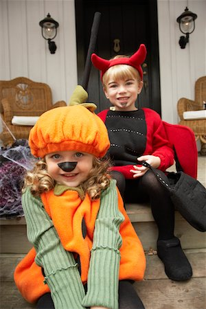 Portrait of Girl Dressed-up as Pumpkin and Boy Dressed-up as Devil Stock Photo - Premium Royalty-Free, Code: 600-01717680