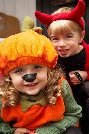 Portrait of Girl Dressed-up as Pumpkin and Boy Dressed-up as Devil Stock Photo - Premium Royalty-Free, Code: 600-01717681