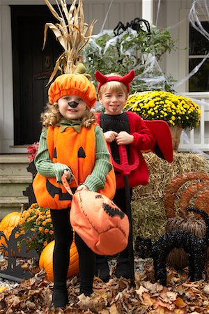 Portrait of Girl Dressed-up as Pumpkin and Boy Dressed-up as Devil Stock Photo - Premium Royalty-Free, Code: 600-01717682