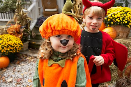 Portrait of Girl Dressed-up as Pumpkin and Boy Dressed-up as Devil Stock Photo - Premium Royalty-Free, Code: 600-01717683