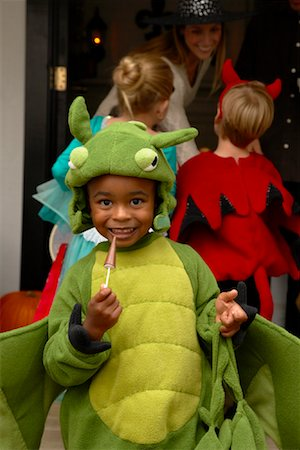 Portrait of Boy with other Children Trick or Treating at Halloween Stock Photo - Premium Royalty-Free, Code: 600-01717696