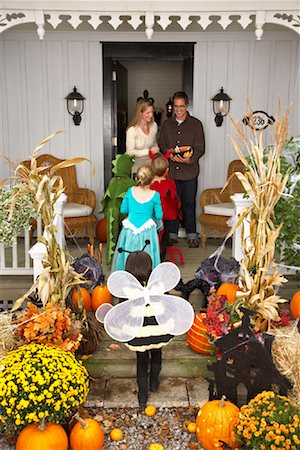 Children Trick or Treating at Halloween Stock Photo - Premium Royalty-Free, Code: 600-01717690