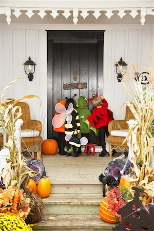 Children Trick or Treating at Halloween Stock Photo - Premium Royalty-Free, Code: 600-01717693