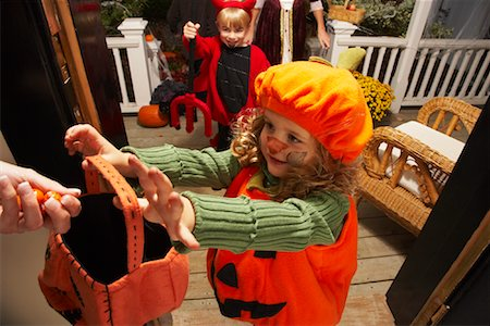 Portrait of Girl and other Children Trick or Treating at Halloween Stock Photo - Premium Royalty-Free, Code: 600-01717708