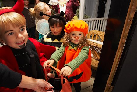 Children Trick or Treating at Halloween Stock Photo - Premium Royalty-Free, Code: 600-01717709