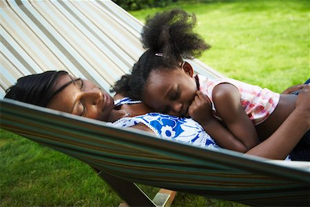 Mother and Daughter Sleeping in Hammock Stock Photo - Premium Royalty-Free, Code: 600-01717920