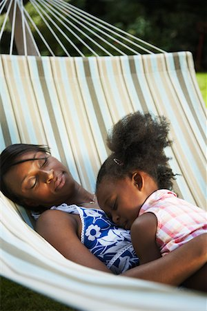 Mother and Daughter Sleeping in Hammock Stock Photo - Premium Royalty-Free, Code: 600-01717921