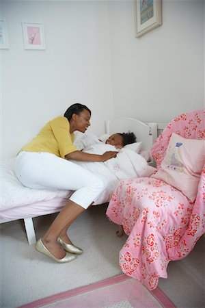 Mother Tucking Daughter into Bed Stock Photo - Premium Royalty-Free, Code: 600-01717969