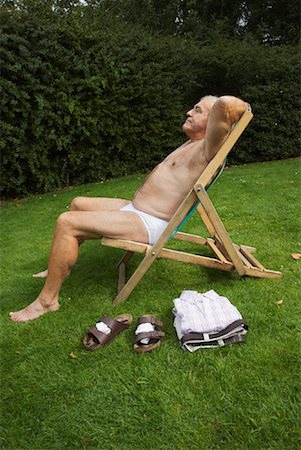Man Sitting in Lawn Chair in His Underwear Stock Photo - Premium Royalty-Free, Code: 600-01717989